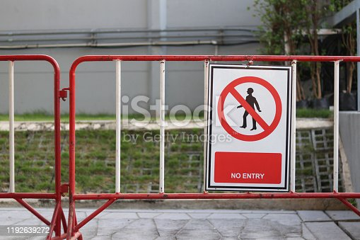 istock A sign strictly prohibiting this route. No entry sign hanging on iron fence. 1192639272
