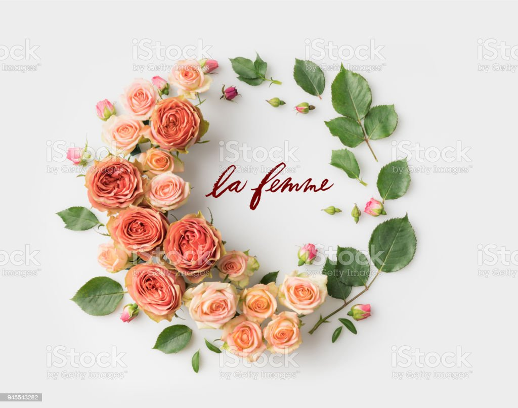 Le Femme Sign Surrounded With Pink Flower Wreath With Leaves Buds