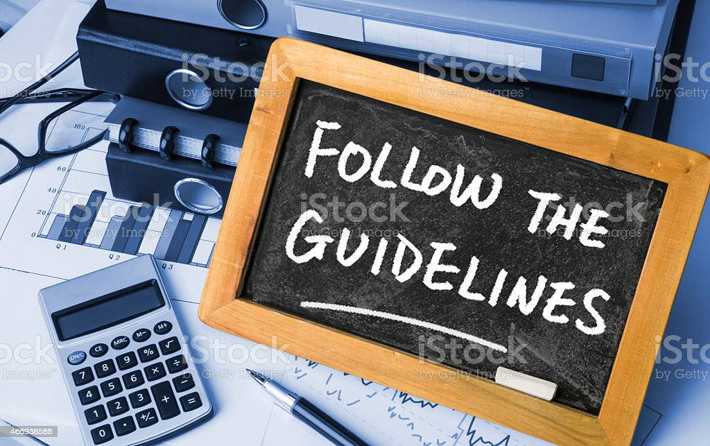 Sign telling us to follow the guidelines stock photo