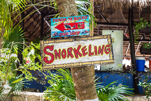 "A sign that says ""snorkeling"" on Palancar beach in Playa Palancar, Quintana Roo, Mexico"