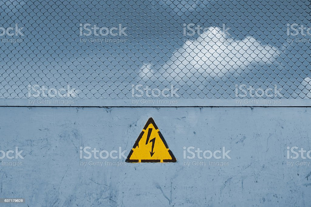 sign unsafe, high voltage and grid stock photo