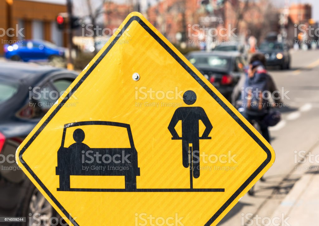 Sign urging drivers and cyclists to share the road stock photo