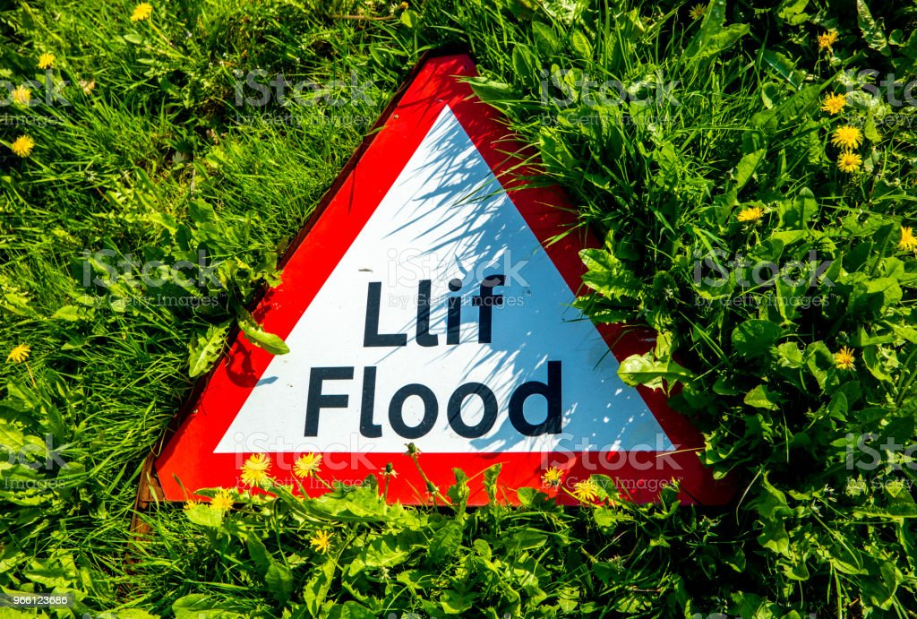 Sign warning in welsh and english of a flooding - Royalty-free Accessibility Stock Photo
