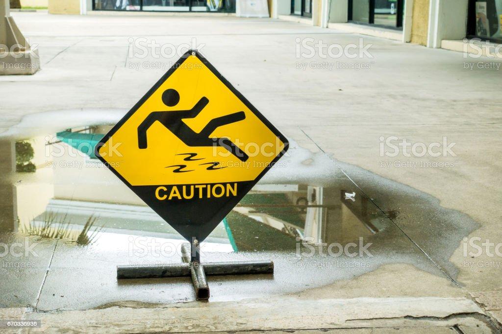 Sign warning of caution wet floor. stock photo