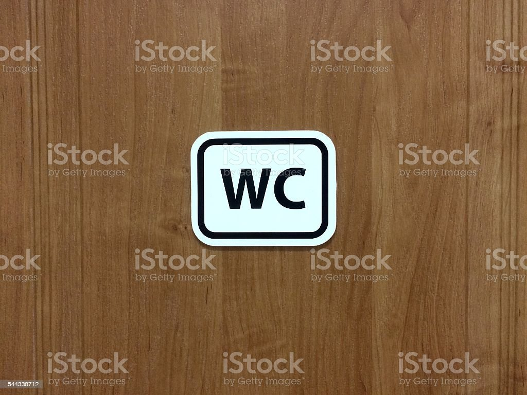 Sign WC on the wooden background. Symbol of toilet. stock photo
