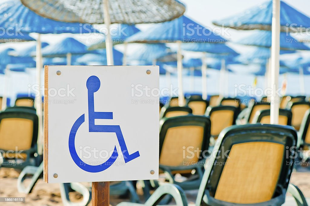 sign wheelchair close-up on the beach royalty-free stock photo