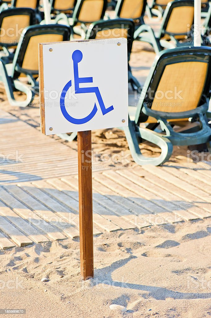 sign wheelchair set on  beach by the sea royalty-free stock photo