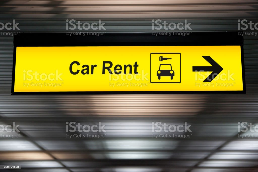 sign with arrow point to rent a car service at the airport for passenger who want to hide a car for travel around city. freedom transportation for convenient travel stock photo