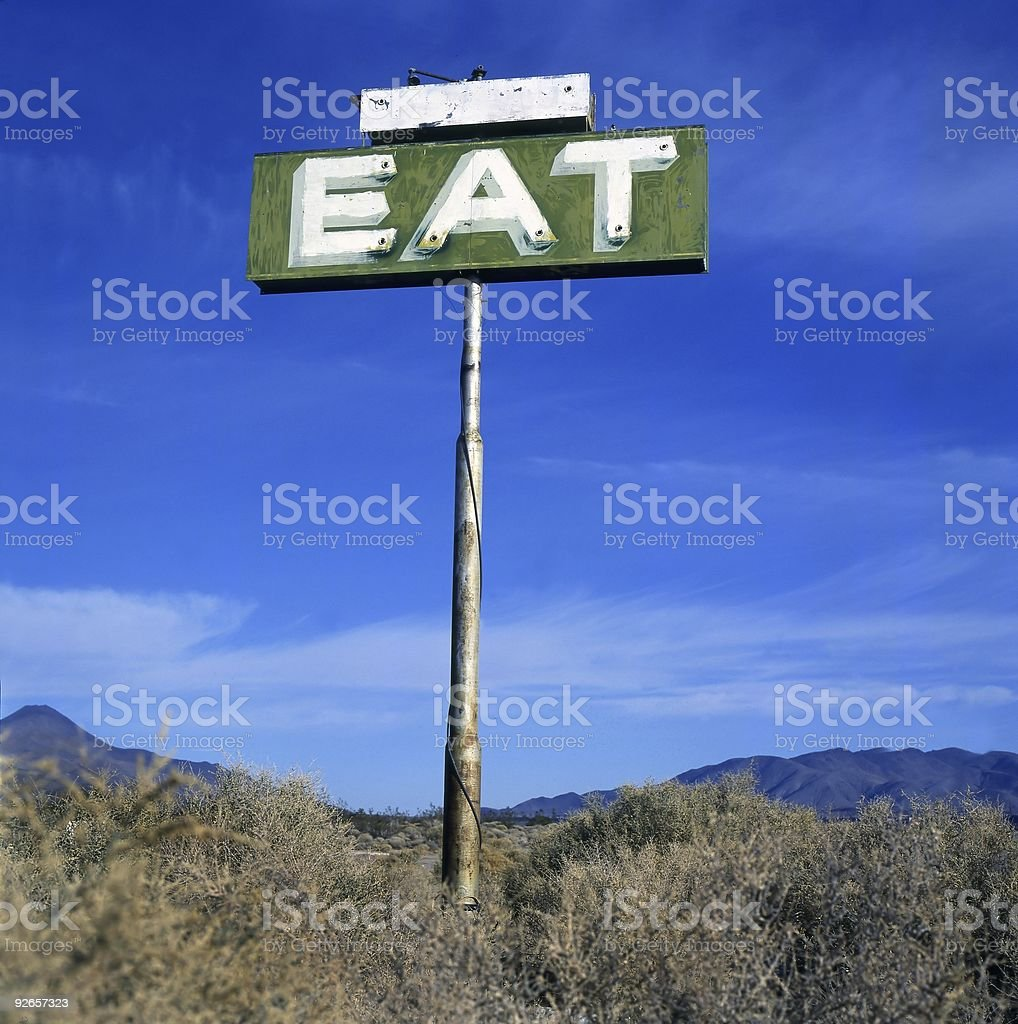 Sign with inscription 'EAT' royalty-free stock photo