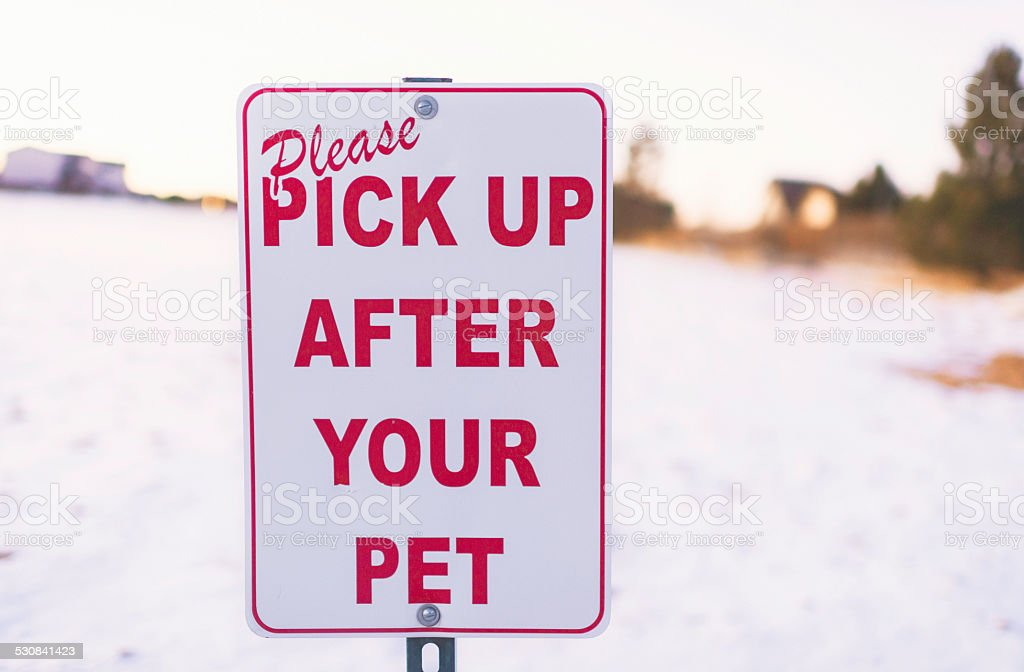 Sign with reminder to clean up after your pet