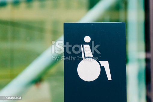 666724598 istock photo Sign with symbol wheelchair user shows the way to barrier-free access 1208386103