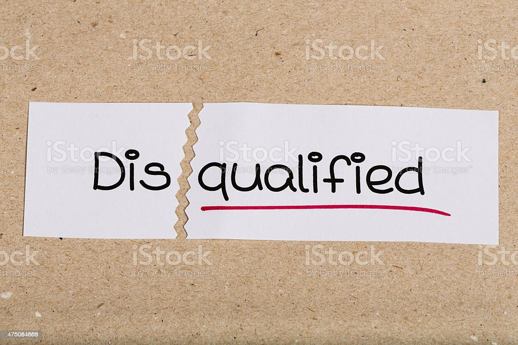 Sign with word disqualified turned into qualified stock photo