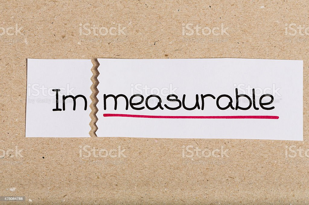 Sign with word immeasurable turned into measurable stock photo