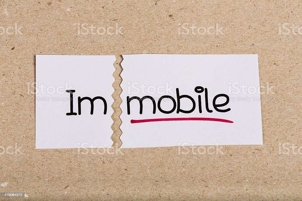 Sign with word immobile turned into mobile stock photo