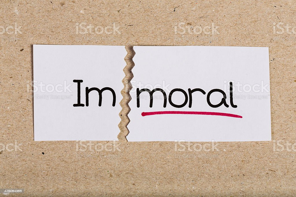 Sign with word immoral turned into moral stock photo