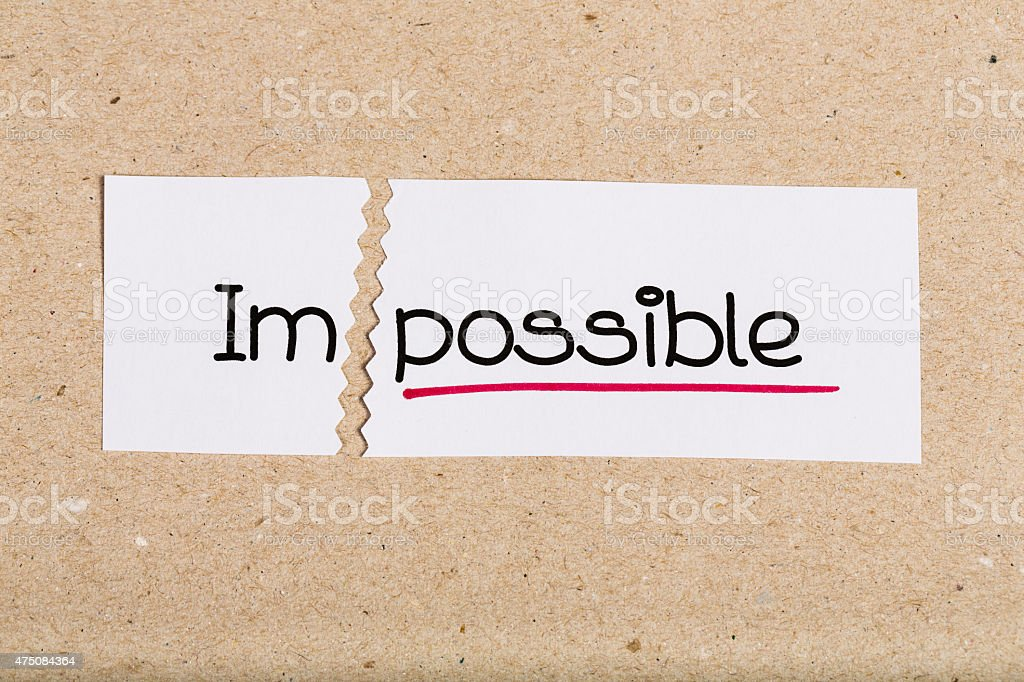 Sign with word impossible turned into possible stock photo