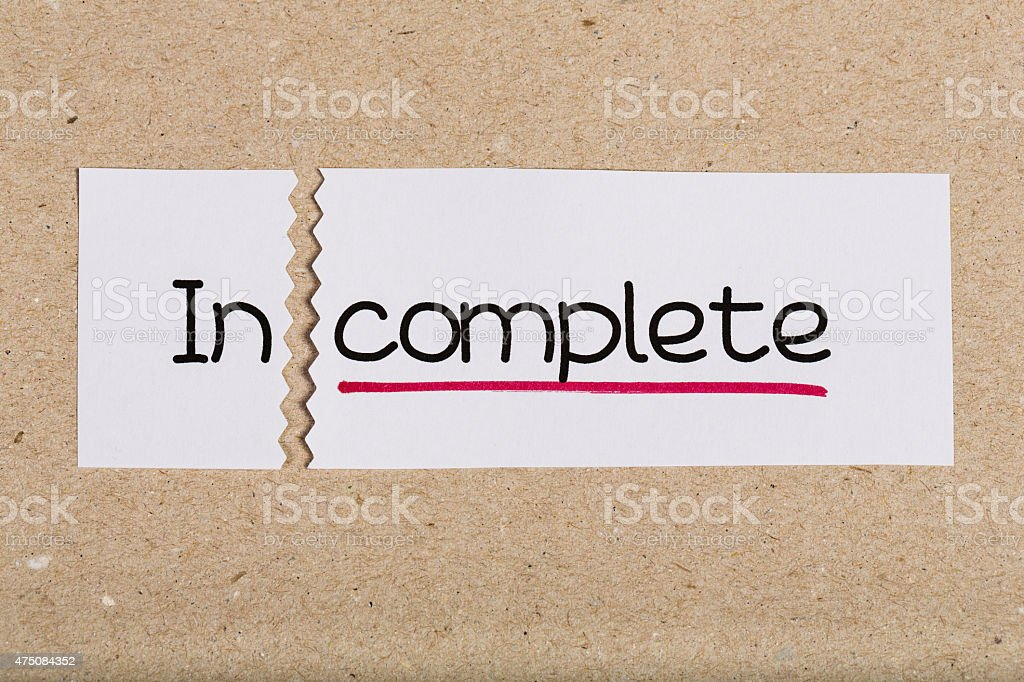 Sign with word incomplete turned into complete stock photo