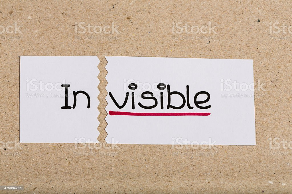 Sign with word invisible turned into visible stock photo