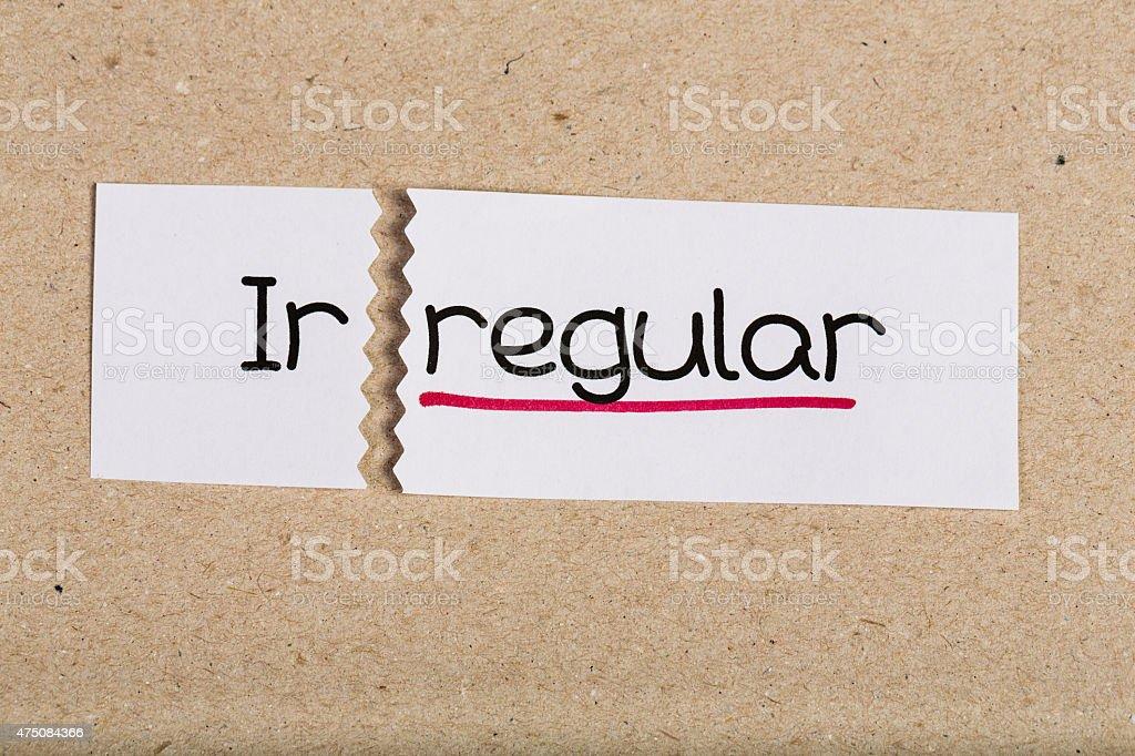 Sign with word irregular turned into regular stock photo