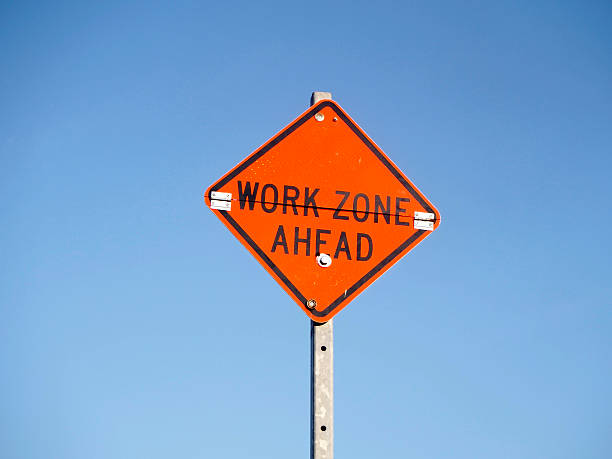 Sign work zone ahead Sign work zone ahead time zone stock pictures, royalty-free photos & images