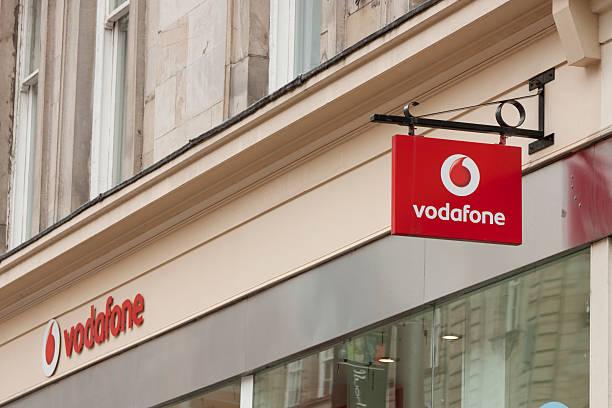 Signage at a Vodafone shop stock photo