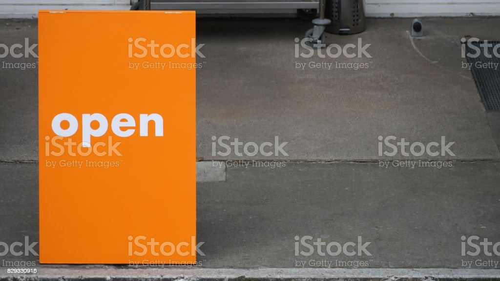 A signage placed on a cement floor as a background
