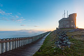 St. John's, NL Canada - June 16, 2018: Signal Hill National Historic Site in fog. Signal Hill recalls the town's historic past and communications triumph, as well as offering coastal hikes and colourful performances against sweeping views overlooking the Atlantic.