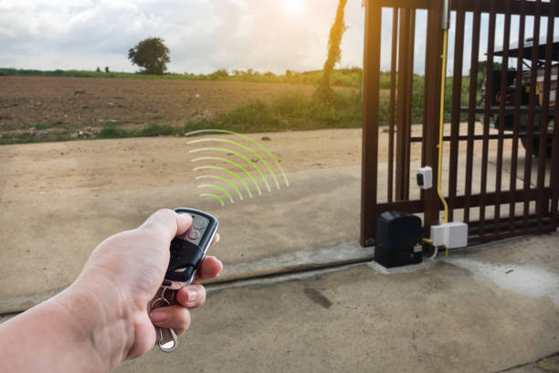 Signal of remote control when person open automatic gate at house system Signal of remote control when person open automatic gate at house system automatic stock pictures, royalty-free photos & images