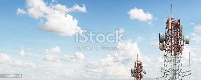 Signal tower for communication industrial on blue sky background
