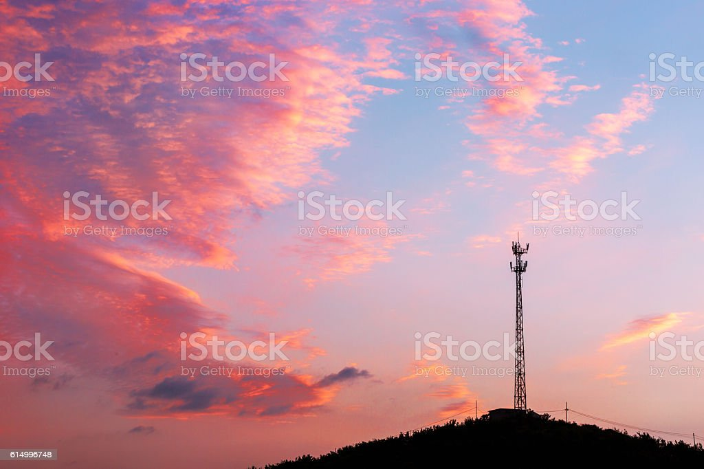 signal tower on the top of hill stock photo