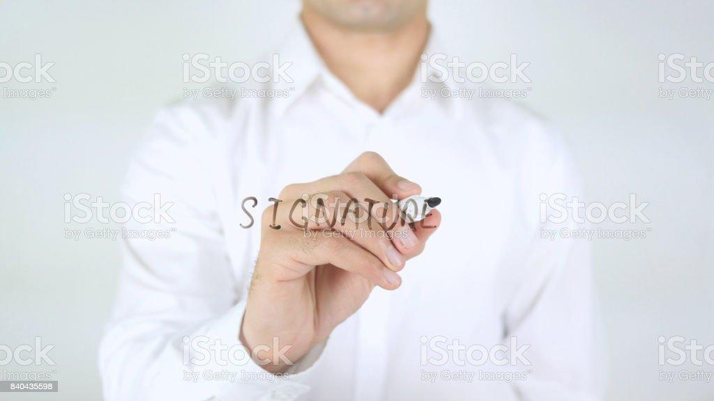 Signature, Man Writing on Glass stock photo