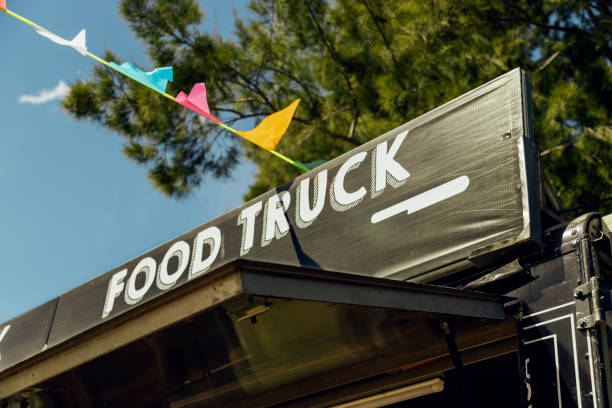 Signboard of a food truck with colorful pennants stock photo