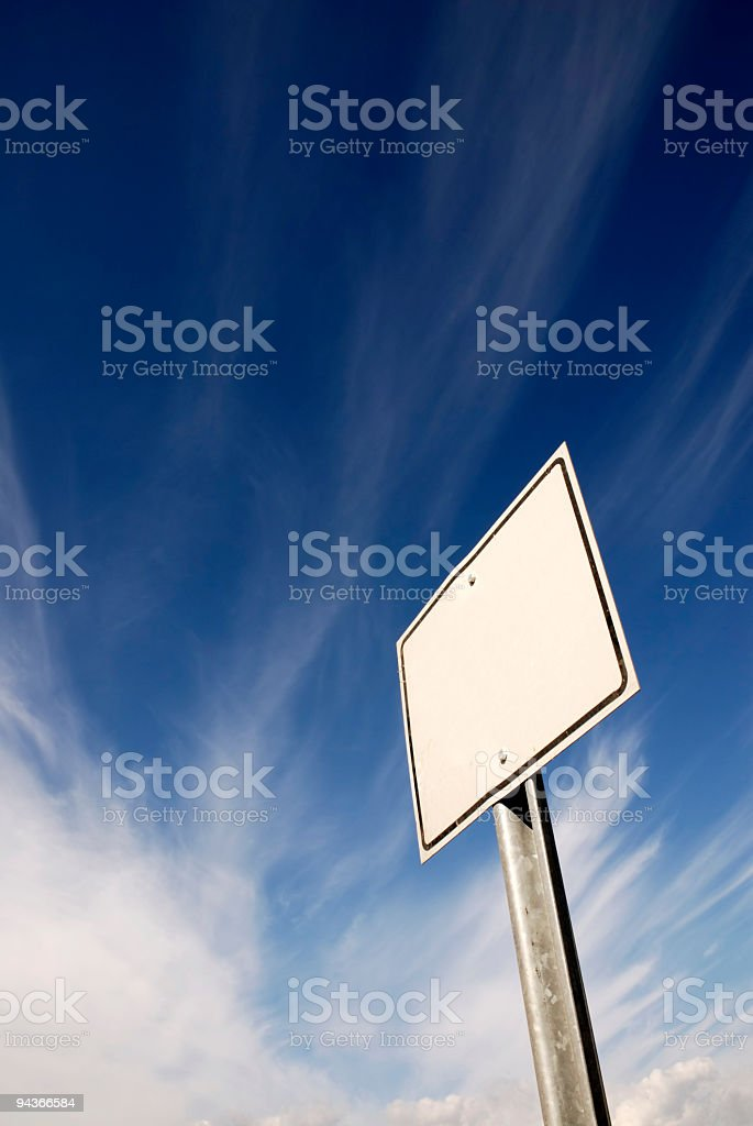 Signboard On Cloudy Blue Sky royalty-free stock photo