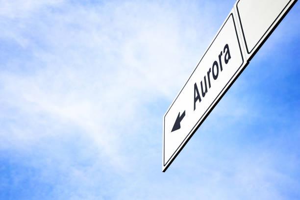 Signboard pointing towards Aurora stock photo