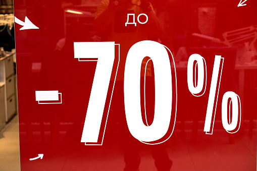 Signboard sale. Russian language sale. Discounts up to 70 percent.