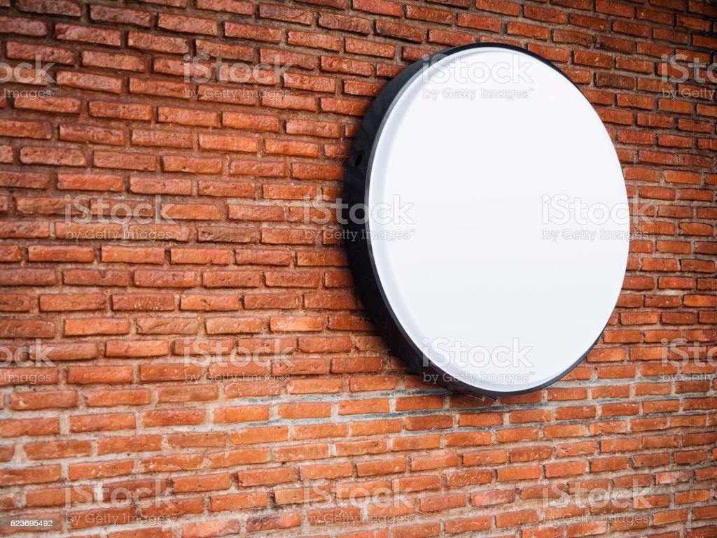 Signboard shop Mock up Logo Circle Display on Brick wall stock photo