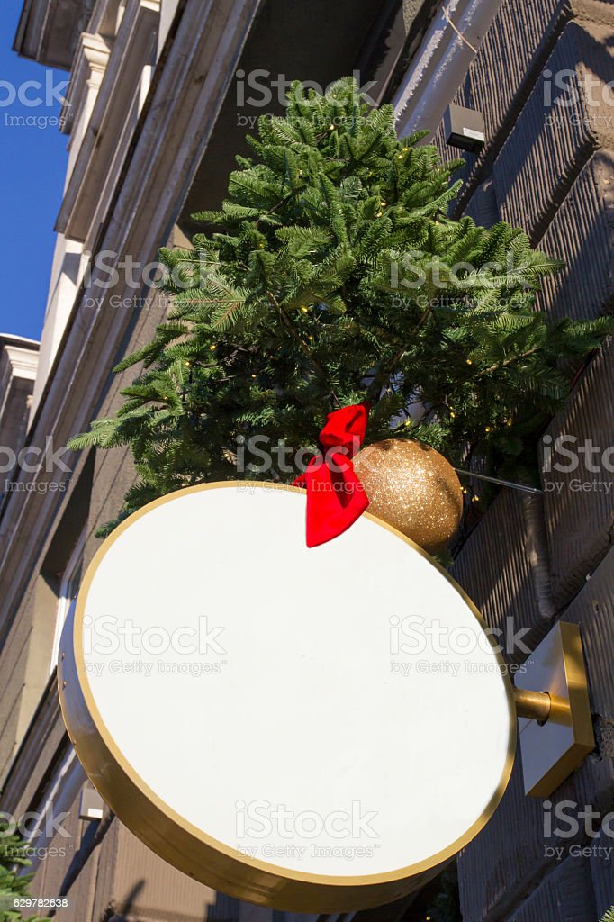 Signboard with Christmas decorations. Mock up. Round shape stock photo
