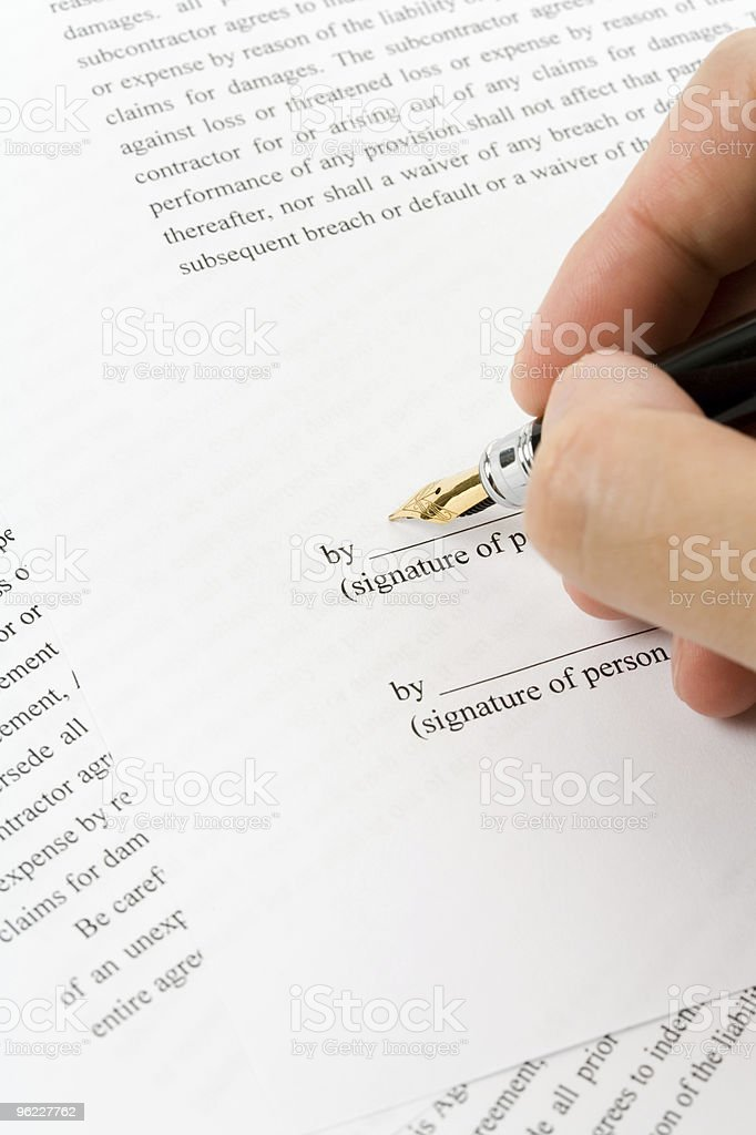 Signing a business contract close-up stock photo