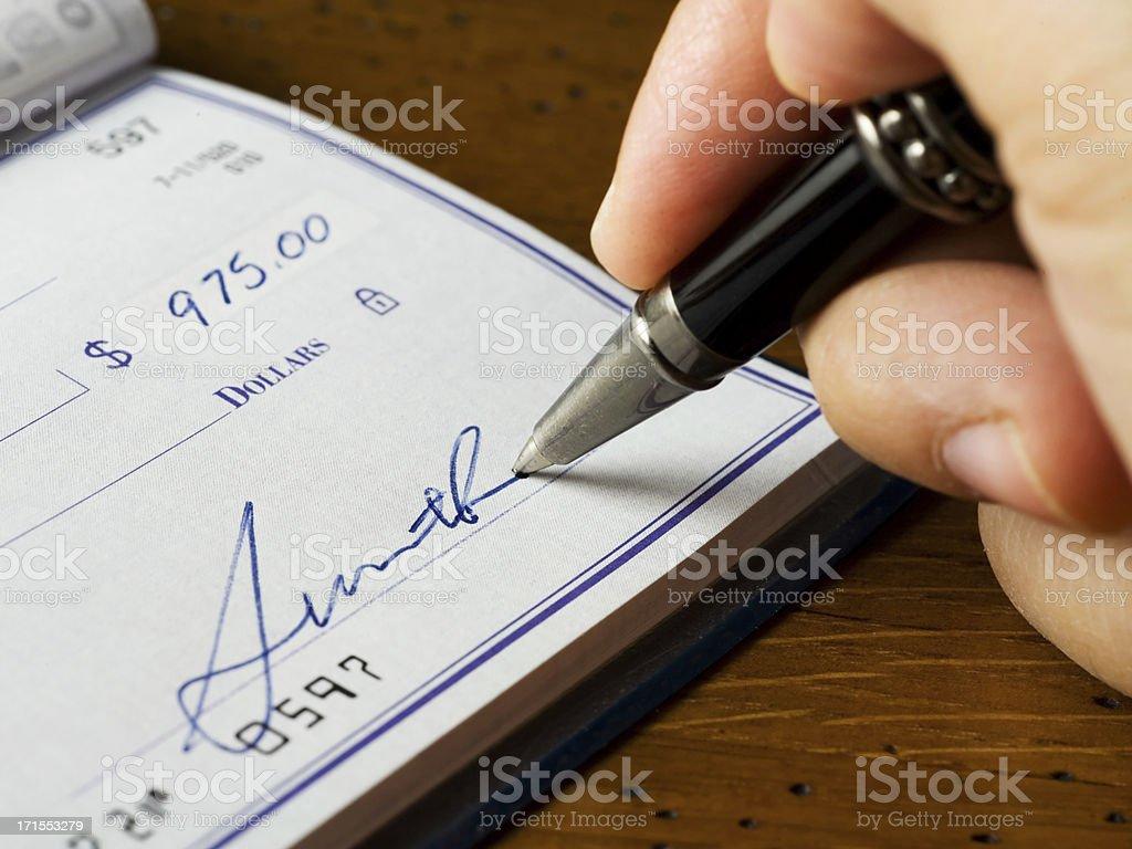 Signing a Check royalty-free stock photo