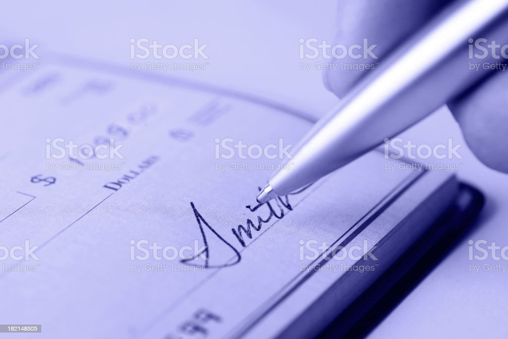 Signing a Check stock photo