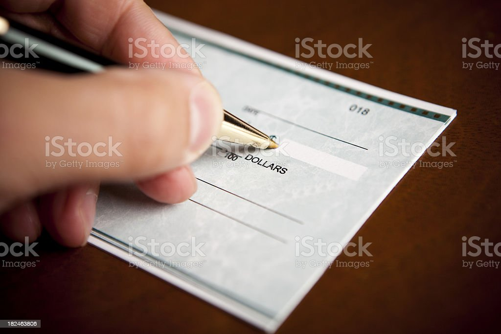 Signing a check with in pen royalty-free stock photo