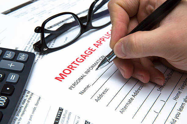 signing a contract - mortgages and loans stock pictures, royalty-free photos & images