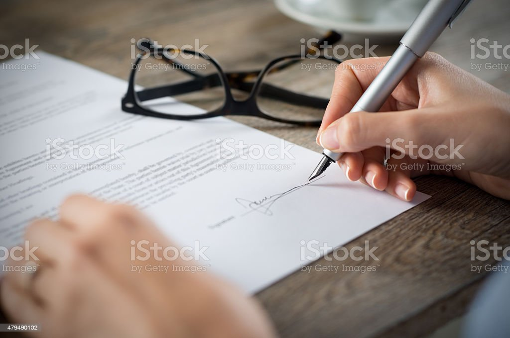 Signing a form stock photo