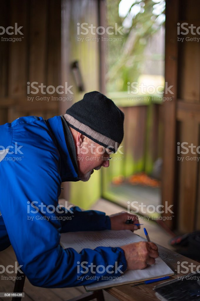 Signing a guestbook in a fairytail shimmer stock photo