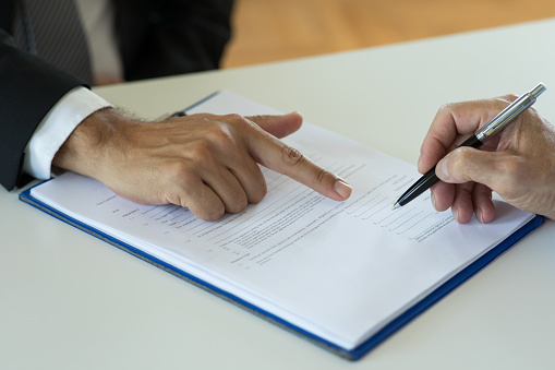 1072035844 istock photo Signing a mortgage contract 1270821563