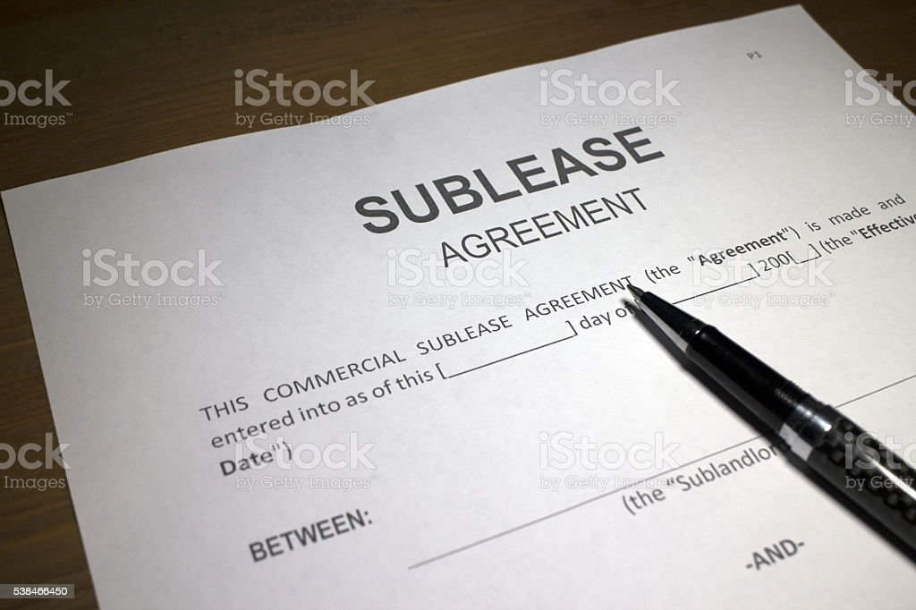 Signing a Sublease Agreement stock photo