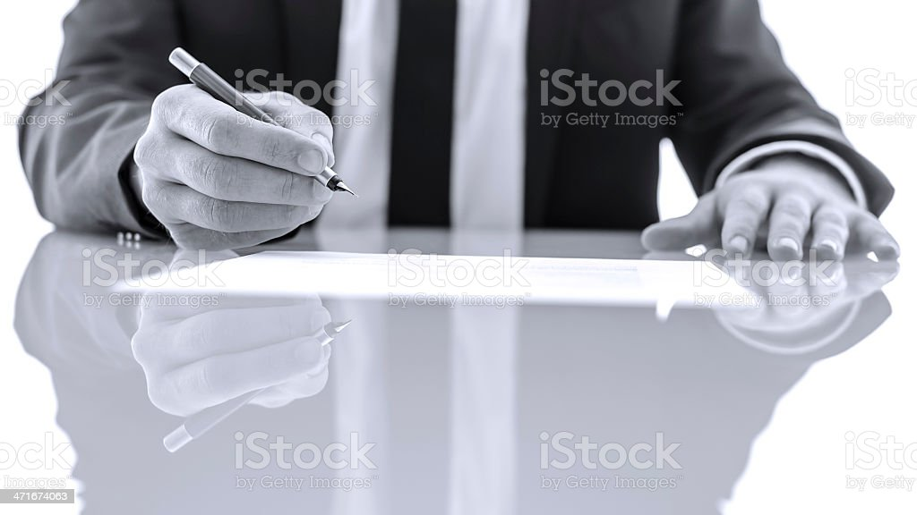 Signing and reading legal papers royalty-free stock photo
