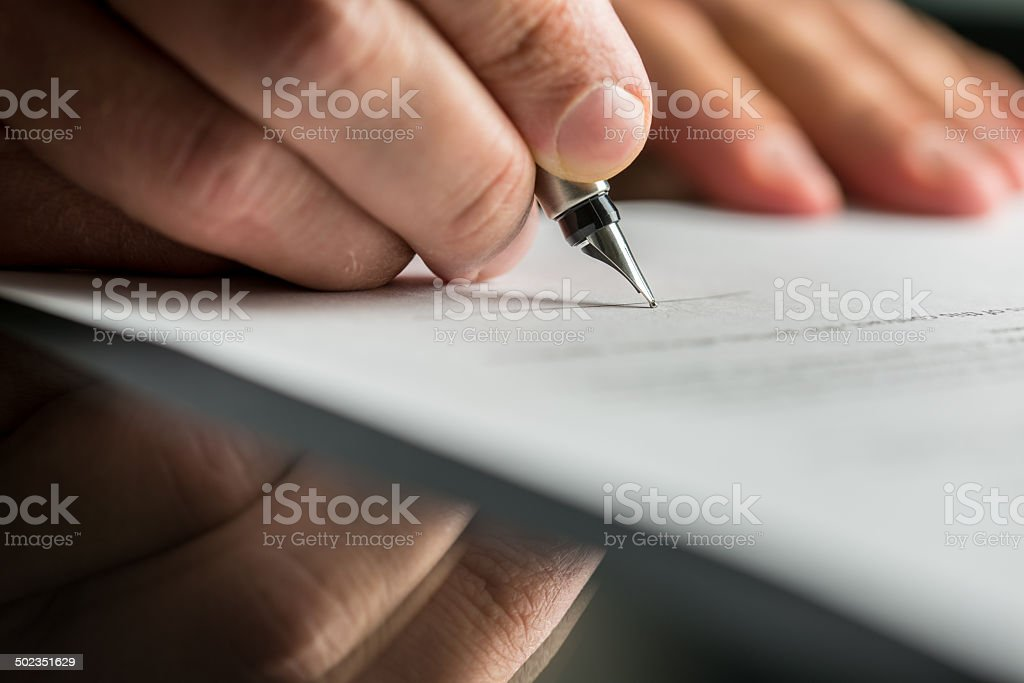Signing business contract stock photo
