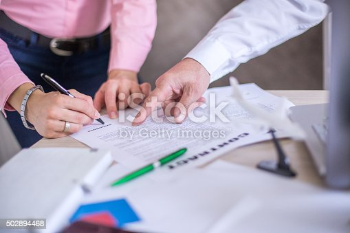 501040002istockphoto Signing contract 502894468