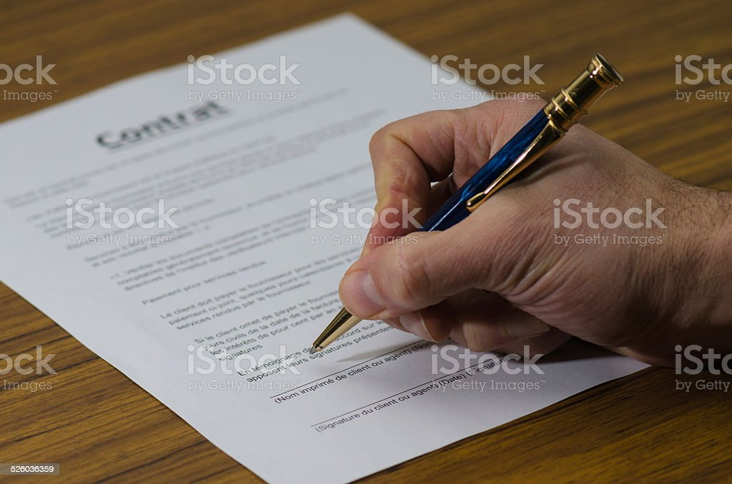 Signing contract (in french) stock photo